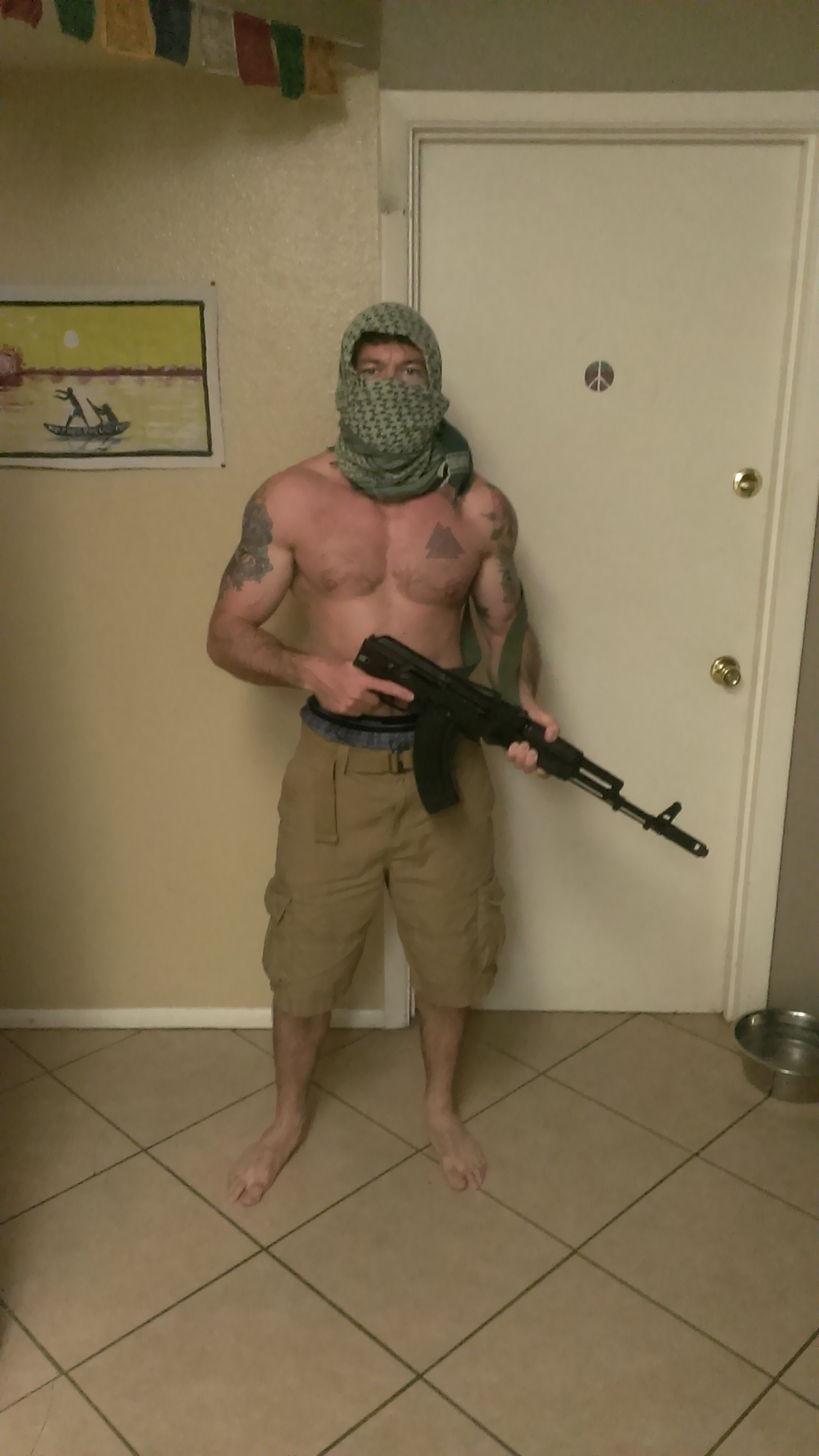 Cody William Moreash, 32, national head of the clandestine Atomwaffen Division terror group in his home in Tempe, Arizona in 2018 (Photo ©Nate Thayer)